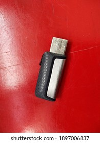 A flashdisk isolated on red background.