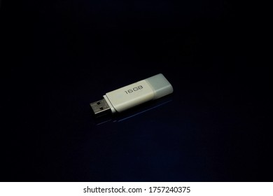flashdisk usb stick 16 gigabyte on black background