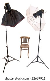 The flashing lights in atelier. Studio lighting with a chair, isolated on a white background. The studio set for shooting. Empty photo studio with wooden seat and lighting equipment