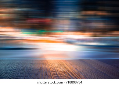FLASHLIGHT OF BLURRED MOTION IN THE CITY STREET