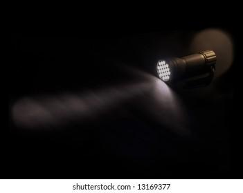 flashlight glowing on the dark