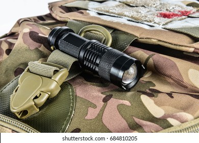 Flashlight on a backpack coloring khaki