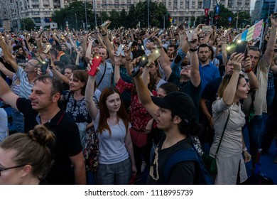 Flashlight protest/Protesters against new justice laws, corruption and government are lighting their smartphone flashlights. Bucharest, Romania, June 21, 2018.