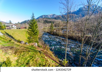 Flashy river on the scenic background of Bavarian Alps and fall landscape.