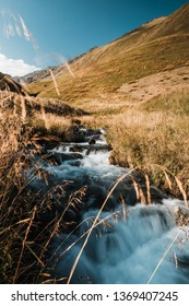 flashy stream flowing in mountain valley