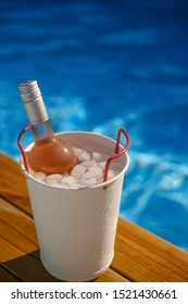 Flask of rose wine at the pool with some ice