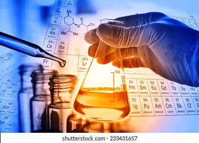 Flask in scientist hand with test tubes