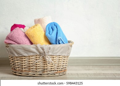 Flasket of clean towels on table