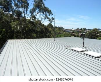 Flat aluminum roof top under the hot sun