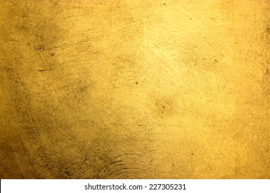 flat background, gilded gold leaf
