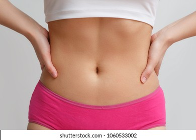 flat belly with hands on belt