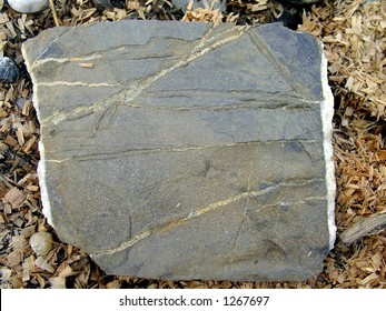 Flat big stone like the page of a book.
