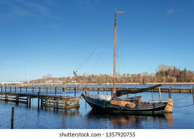 flat bottomed sailing boat with sideswords