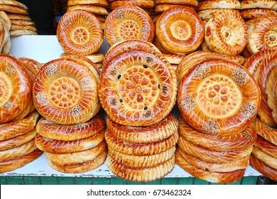 Flat cakes from tandoor on market counter in Bishkek, Kyrgyzstan