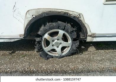 Flat caravan tyre on side of road in New Zealand