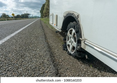Flat caravan tyre on side of highway in New Zealand