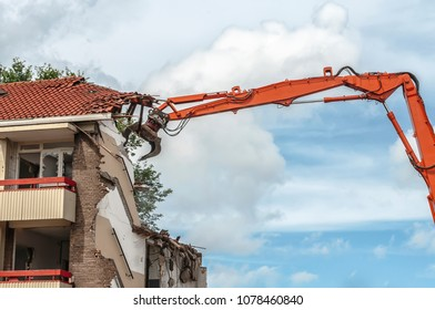 flat is demolished with a grabber crane