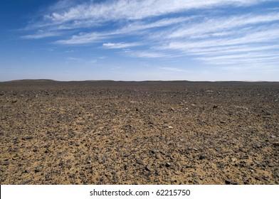 Flat Desert of black stones - Sahara - Best of Morocco