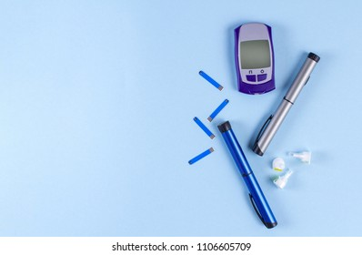 flat diabetes insulin pens with glucometer. Copy space