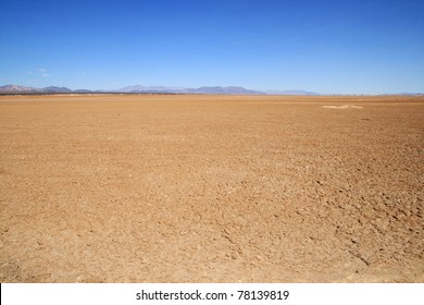 flat empty Mojave Desert floor with distant mountains on the horizon