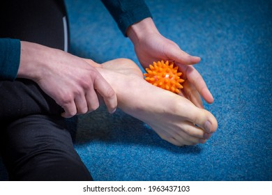 flat feet massaging with a ball
