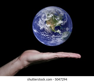 Flat Hand With Floating Earth. Some components of this montage are provided courtesy of NASA, and have been found at http://visibleearth.nasa.gov