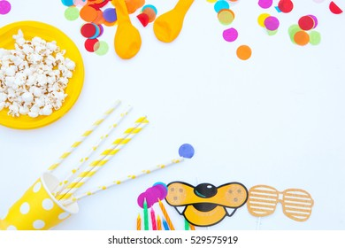 Flat lat lay party decorations on white background.