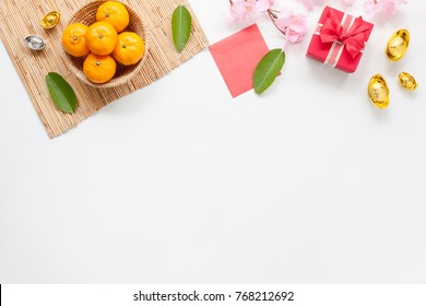 Flat lay of accessories Chinese new year and decorations Lunar new year festival concept background.Difference items on modern white wooden at office.Other language mean rich or wealthy and happy.