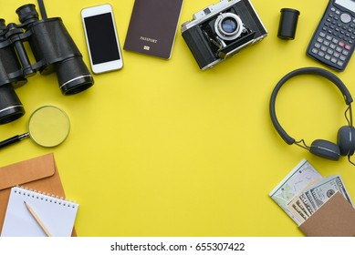 Flat lay of accessories on yellow desk background of photographer, Voyage concept.
