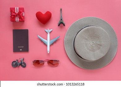 Flat lay aerial image of travel background concept.Table top view of souvenir symbol location or landmark of place for traveler at Paris France.objects on  rustic pink wooden.space for mock up & page.