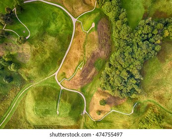 Flat lay, aerial top view of medieval hillfort mounds in Kernave, historical capital city of Lithuania (Sirvintos district). Kernave Archaeological Site is included into UNESCO world heritage list.