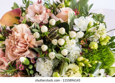 Flat lay of a beautiful florish bouquet composition on white background