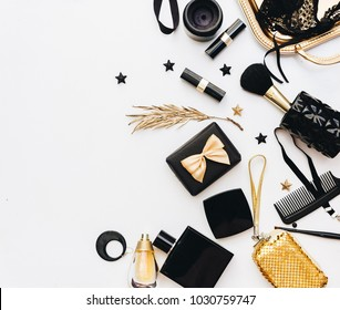 Flat Lay, Beauty blog concept. Female make up and accessories on white background. top view of black and gold trendy fashion feminine background.