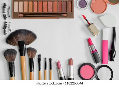 Flat lay of beauty cosmetic products and Various Make up accessories on the white background with copy space for your text. Concept of Beauty Knolling.