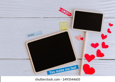 Flat lay black plain wooden tags decorate with stickers on white wooden background. Simple and minimal vintage style for frame, picture and message. Copy space for text. Love photo concept.