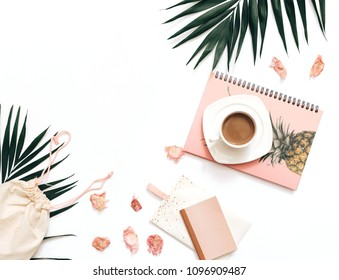 Flat lay blogger workspace mockup with tropical leaves , coffee and accessories on white background. Copy space
