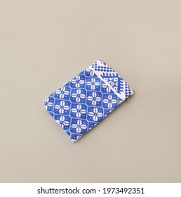 Flat lay blue and white fabric zipper pouch