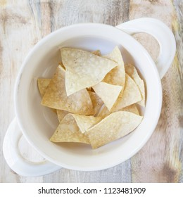 Flat lay of  bowl  with tortilla chips, ready for filling with soup. (second of five in series)