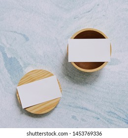 Flat lay branding identity business name card on wooden container with blue marble background, minimal concept for design