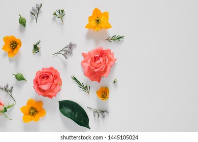 Flat lay bright creative pattern of fresh flowers and leaves natural background. Flowers pattern.
