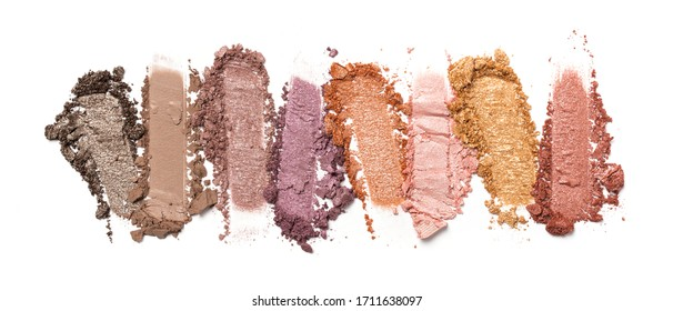 Flat lay of brush stroke. Broken shiny color eyeshadow as sample of cosmetic beauty product isolated on white background