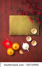 Flat lay Chinese new year food and drink still life on rustic wooden background. Translations of text appear in image: Prosperity & Spring.