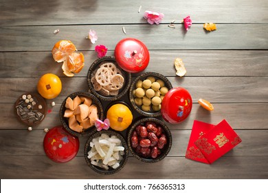 Flat lay Chinese new year food and drink, reunion dinner food still life on red table top background. Translation of texts appear in image: Prosperity.
