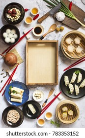 Flat lay Chinese new year food and drink on marble table top. Text space image.