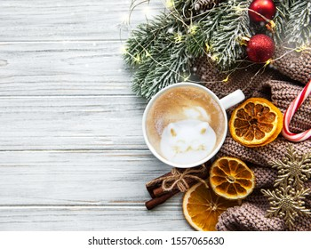 Flat lay Christmas composition with coffee, decorations and  fir tree on a white wooden table.