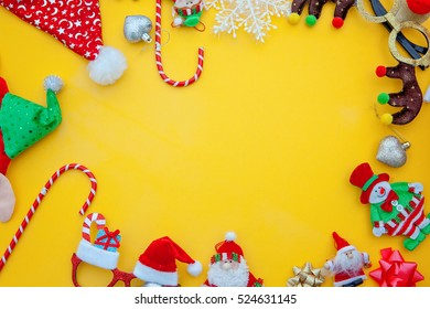 flat lay of christmas items in a frame.Yellow background