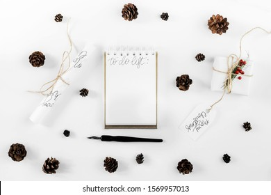 Flat lay christmas notepad mockup whis fir branches and cones .  White paper sheet clip board mock up. Winter holidays mood for hand lettering. Merry christmas happy new year.