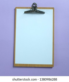 flat lay Clipboard  on the purple background, Copy space for design. office concept