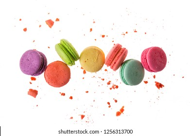 Flat lay. Close up. Sweet french macarons isolated on white background. Colorful macaroons flying or falling in motion.