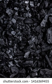 Flat lay of coal mineral black stones background. Coal pattern studio background